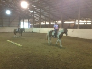girls riding indoor arena